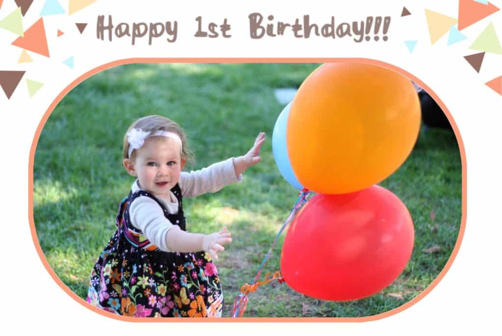 Baby with birthday balloons