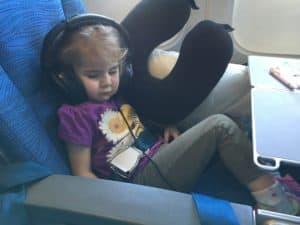 kid sleeping on the plane